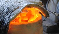 Another image showing bronze being melted in a kiln