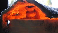 Bronze being melted in a kiln