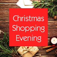 Christmas shopping event promotional image with pine sprigs, cinnamon, a present and candle