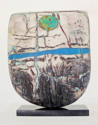 Ceramic piece by Peter Hayes. Tribalistic style with mother of pearl finish.