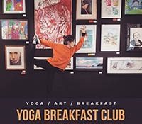 Yoga teacher Maddie, performs a standing balance in front of a wall of paintings and drawings. There is some text beneath it reading yoga, art, breakfast. Followed by Yoga breakfast club.