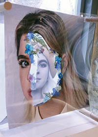 multiple layers of portraits suspended from a frame so you can see different sections of the images