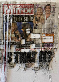 stitching into newspaper, featuring the text