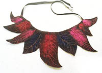 Textile necklace. Red, pink and purple fleece, moulded into feathers.