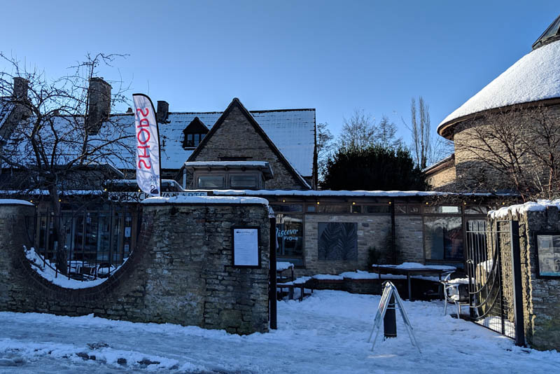 Black Swan Arts garden entrance in the snow. Showing the Round Tower to the right..